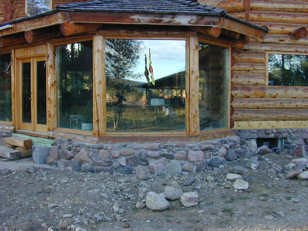 the house a log home with radiant wood floors insulated stone